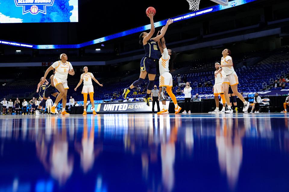 Michigan's Naz Hillmon (00) drives to the basket ahead of Tennessee's Jordan Walker (4) during their second-round game.