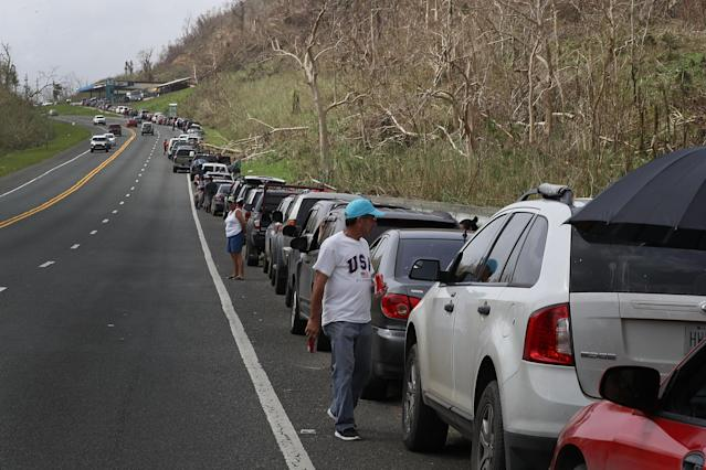 <p>People wait in line as they hope to fill up their vehicles with gas in the aftermath of Hurricane Maria on September 27, 2017 in Corozal, Puerto Rico. (Photo: Joe Raedle/Getty Images) </p>
