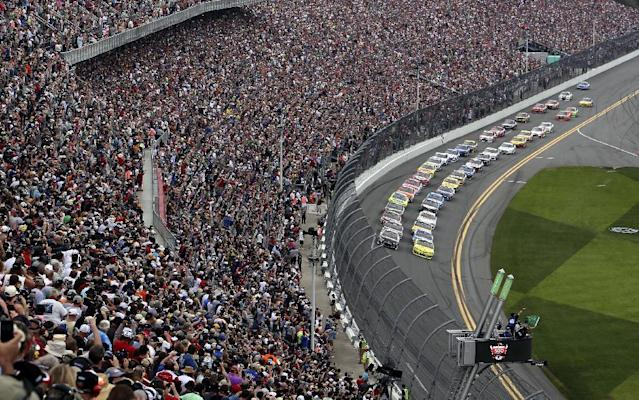 The field take the green flag to start the NASCAR Daytona 500 Sprint Cup series auto race at Daytona International Speedway, Sunday, Feb. 23, 2014, in Daytona Beach, Fla. (AP Photo/David Graham)