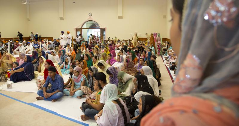 Members of the Sikh temple of Wisconsin pray inside the place of worship Sunday, August, 12, 2012.