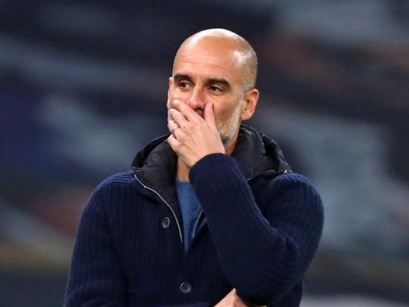 Pep Guardiola gestures on the touchline (POOL/AFP)