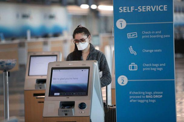 PHOTO: A traveler checks in for a flight at O'Hare International Airport on April 2, 2020 in Chicago. (Scott Olson/Getty Images)