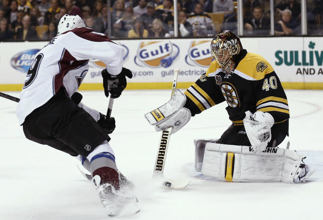Boston Bruins goalie Tuukka Rask makes a save as Colorado Avalanche's Matt Duchene looks for the rebound during the first period of an NHL hockey game in Boston on Thursday, Oct. 10, 2013. (AP Photo/Winslow Townson)