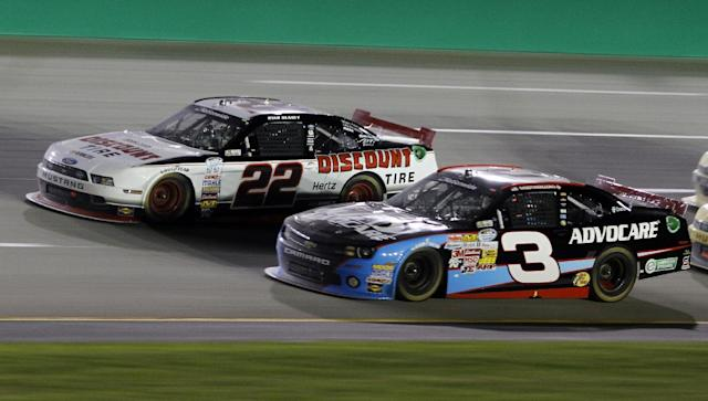 Ryan Blaney (22) pulls away from Austin Dillon (3) late in the NASCAR Nationwide Series auto race, Saturday, Sept. 21, 2013, at Kentucky Motor Speedway in Sparta, Ky. Blaney won with Dillon finishing second. (AP Photo/James Crisp)
