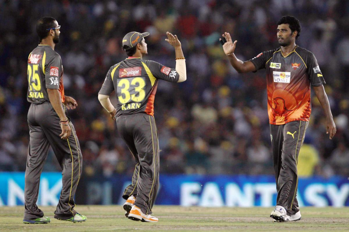 Thisara Perera is congratulated by Amit Mishra on taking the wicket of Piyush Chawla during match 59 of of the Pepsi Indian Premier League between The Kings XI Punjab and the Sunrisers Hyderabad held at the PCA Stadium, Mohali, India  on the 11th May 2013. (BCCI)