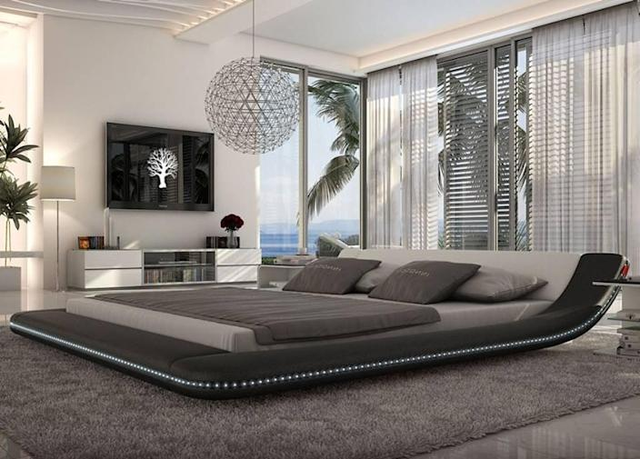 THis ultramodern bedroom makes ample use of black and gray and makes the large bed the star of the show.