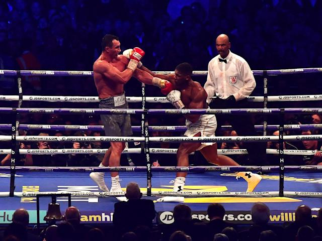 Joshua attempts to land a right hook: Getty
