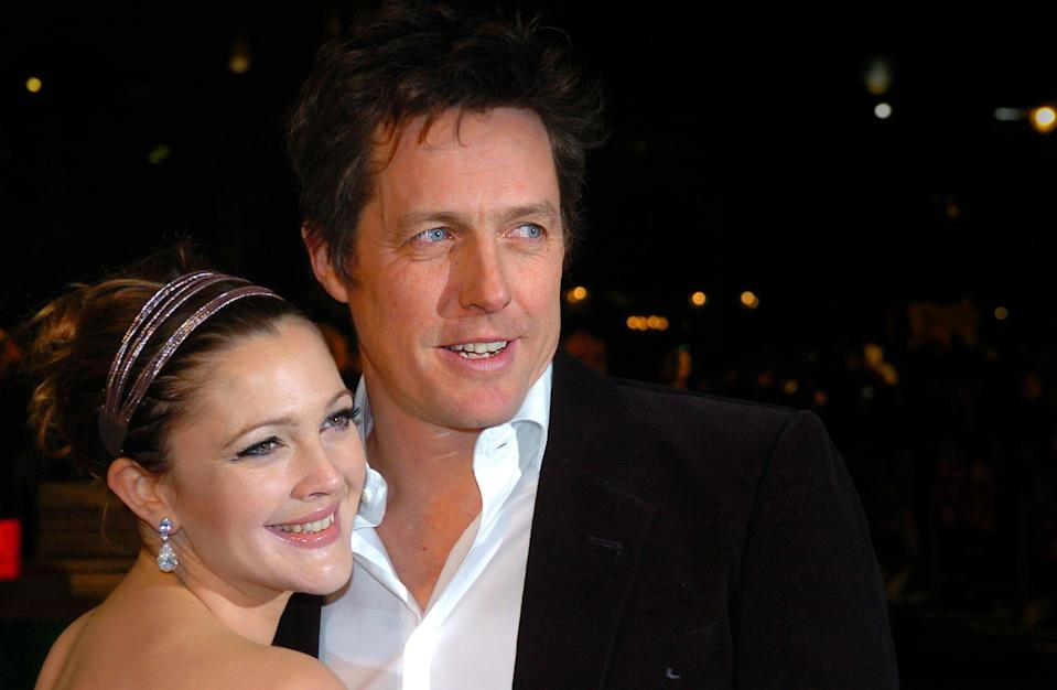 Drew Barrymore and Hugh Grant arrive for the Charity World Premiere of Music and Lyrics at the Odeon Leicester Square in central London.   (Photo by Joel Ryan - PA Images/PA Images via Getty Images)