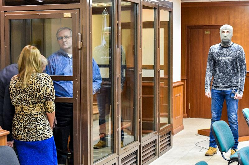 Next to the glass cage where Paul Whelan attended the Moscow hearing stood a man in plain clothes and a balaclava (AFP Photo/Mladen ANTONOV)