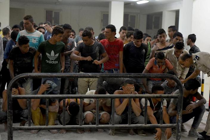 On September 22, 2016, survivors from a boat that capsized off Egypt's north coast gather at a police station in Rashid (AFP Photo/MOHAMED EL-SHAHED)