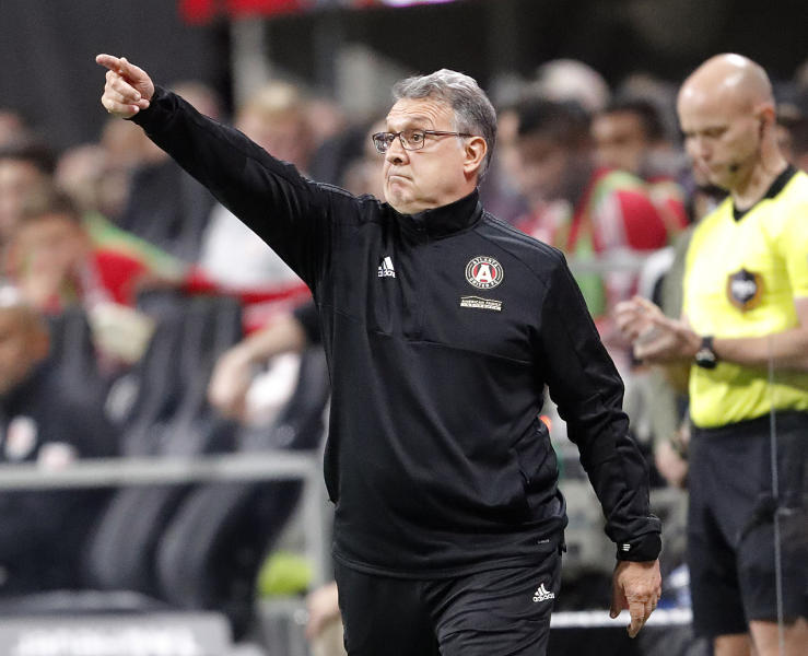 FILE - In this Nov. 25, 2018, file photo, Atlanta United head coach Gerardo Tata Martino directs his players in a MLS soccer playoff game against the New York Red Bulls, in Atlanta. Martino will be celebrated for bringing instant MLS success to Atlanta. If he can add the MLS Cup championship to Atlanta United in his final game as coach, his status as a legend will be difficult for his successor to match. (AP Photo/John Bazemore, File)