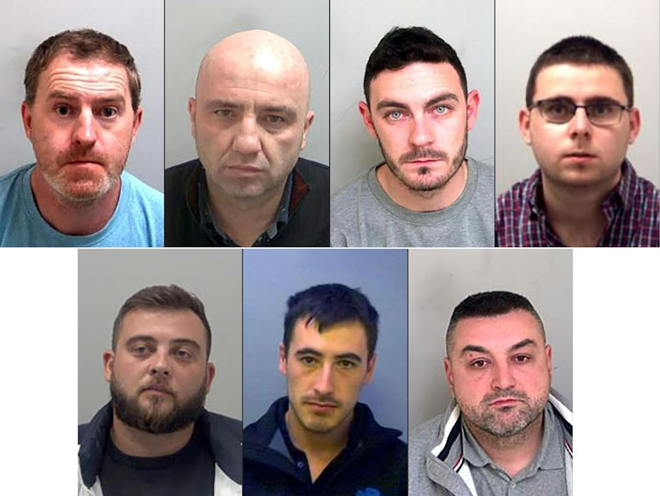(COMBO) This combination of handout pictures created on January 22, 2021, and released by Essex Police, shows top row LtoR: ringleaders Ronan Hughes and Gheorghe Nica, and truck drivers Maurice Robinson and Eamonn Harrison, and botom row LtoR: Ovidiu Hanga, Christopher Kennedy, Valentin Colota, who were all sentenced to prison for their part in a people smuggling plot that led to the death of 39 Vietnamese migrants. - A British judge on Friday handed down sentences of 27 and 20 years to the ringleaders of a people smuggling plot that led to the death of 39 Vietnamese migrants in horrific conditions in the back of a lorry. The 39 -- the youngest of whom were two 15-year-old boys -- suffocated in the container as they were being transported to what they had hoped would be new lives in Britain. The lifeless bodies of the migrants were discovered inside the sealed unit at a port near London in October, 2019. (Photos by - / various sources / AFP) (Photo by -/THAMES VALLEY POLICE/AFP via Getty Images)