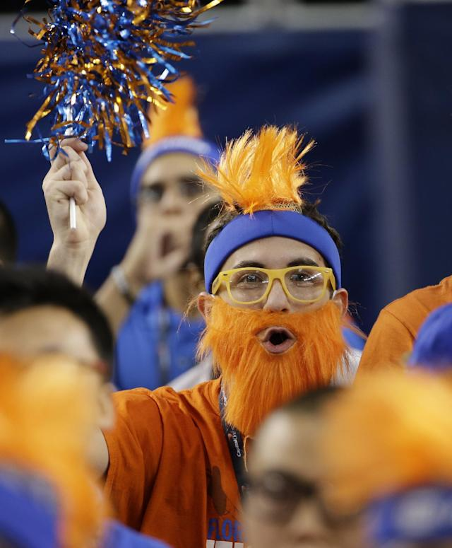 A Florida fan cheers before an NCAA Final Four tournament college basketball semifinal game against Connecticut, Saturday, April 5, 2014, in Arlington, Texas. (AP Photo/David J. Phillip)