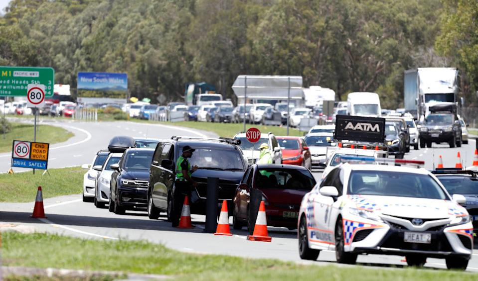 A long queue of motorists entering Queensland from New South Wales through the border checkpoint in Coolangatta on Monday. Source: Getty
