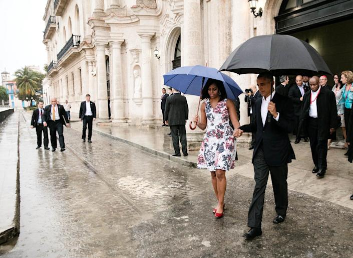 Obama and first lady Michelle Obama walk to the motorcade after touring Old Havana, Cuba.