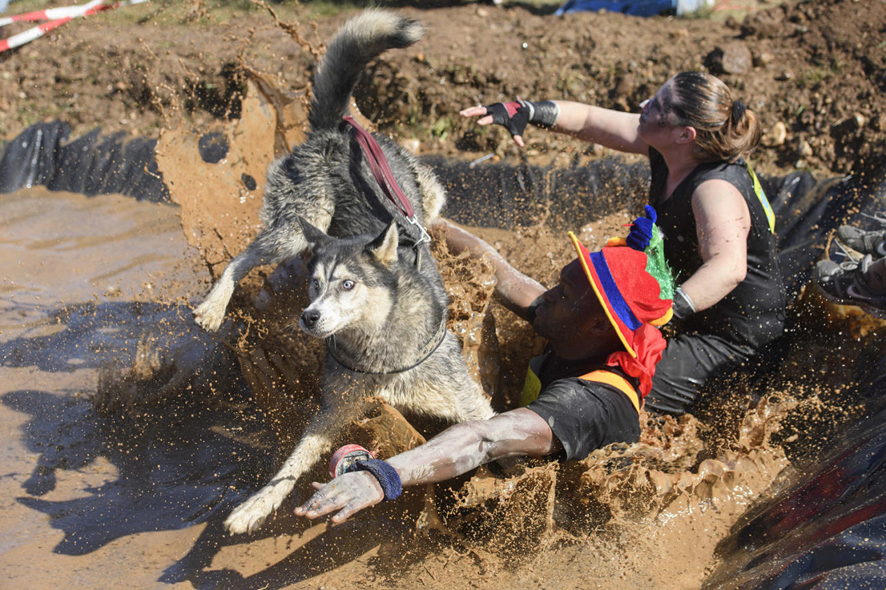 "<p>Participants, one with a dog, take part in the 3rd extreme ""La Barjot Run"" running into the water in Biere, Switzerland, April 8, 2017. Around 1,500 participants have to run a 5 or 9 km track with mud, artificial obstacles and water. (Photo: Martial Trezzini/AP) </p>"