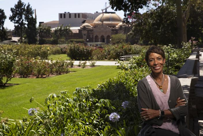 """Judith Sydner-Gordon, a participant in the Natural History Museum of Los Angeles County's oral stories project on voting, gender equity and activism, photographed in Exposition Park with the museum in the distance. <span class=""""copyright"""">(Mel Melcon/Los Angeles Times)</span>"""