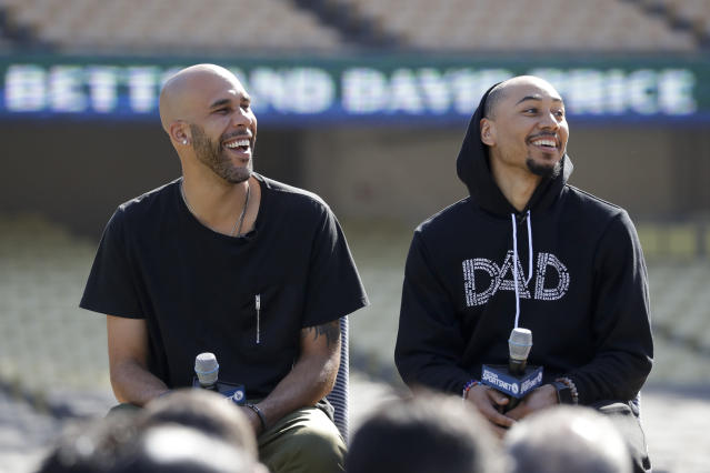 New Los Angeles Dodgers players David Price, left, and Mookie Betts speak during a news conference to announce their acquisition at Dodger Stadium in Los Angeles, Wednesday, Feb. 12, 2020. (AP Photo/Chris Carlson)
