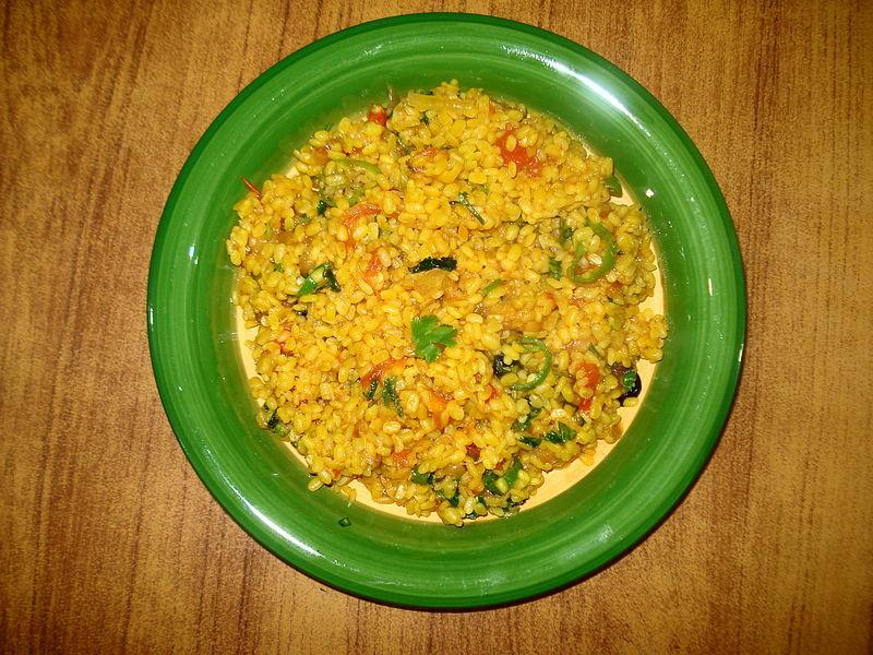 """<p>In this delicious recipe, Moong dal (whole green gram) is cooked with select spices. Pressure cook cleaned one cup moong dal with enough water, 1 tsp chopped ginger, turmeric powder & salt to taste. In a kadhai, add 1 tsp oil, some cumin seeds & one bay leaf. When cumin seeds crackle, one one chopped tomato & saute. Add 1-2 slit green chilies, coriander powder & garam masala to taste. Add cooked dal. Cook till very less water remains & serve garnished with coriander leaves. """"Creative Commons Moong Ki Kharri Dal"""" Miansari66 is licensed under CC BY 1.0 </p>"""