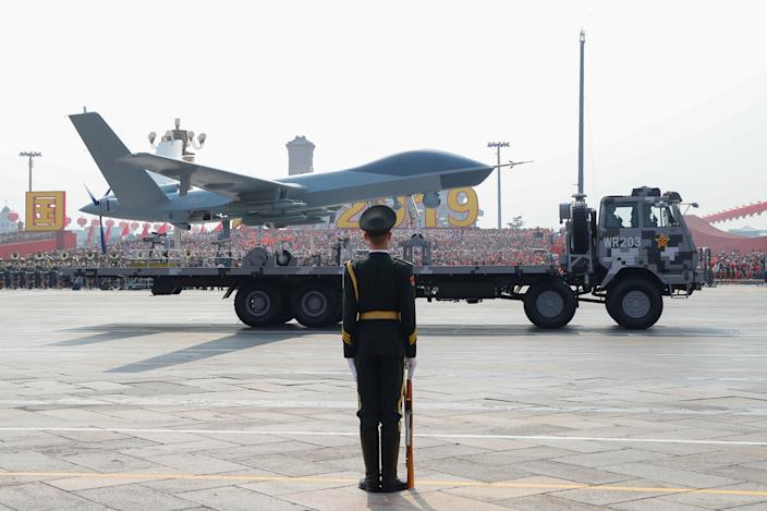A military vehicle carrying an unmanned aerial vehicle (UVA) travels past Tiananmen Square during the military parade marking the 70th founding anniversary of People's Republic of China, on its National Day in Beijing, China October 1, 2019. (Photo: Thomas Peter/Reuters)