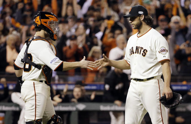 San Francisco Giants' Madison Bumgarner and Buster Posey celebrate after Game 5 of baseball's World Series against the Kansas City Royals Sunday, Oct. 26, 2014, in San Francisco. The Giants won 5-0 to take a 3-2 lead in the series. (AP Photo/David J. Phillip)
