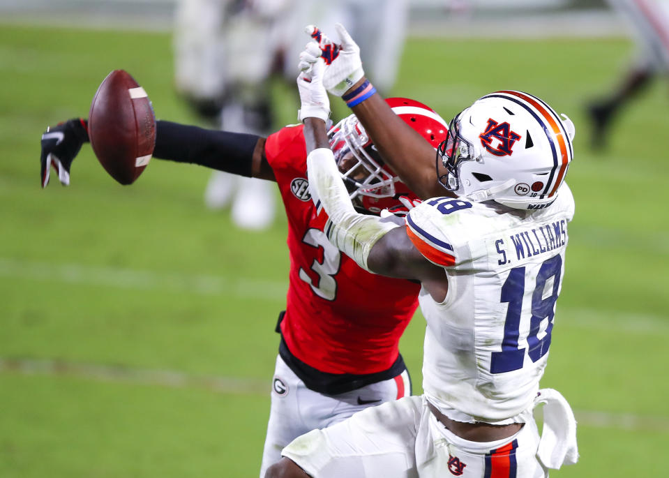 ATHENS, GA - OCTOBER 03: Tyson Campbell #3 of the Georgia Bulldogs breaks up a pass intended for Seth Williams #18 of the Auburn Tigers during the second half of a game at Sanford Stadium on October 3, 2020 in Athens, Georgia. (Photo by Todd Kirkland/Getty Images)