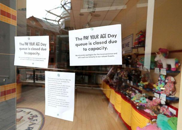 PHOTO: A closed sign on the window of the Build-A-Bear store in Belfast where police were called to deal with crowds who turned up for an over subscribed 'pay your age' promotion, July 12, 2018. (Niall Carson/AP)