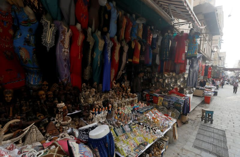 """A shopkeeper waits for customers at a souvenir shop at a popular tourist area named """"Khan el-Khalili"""" in the al-Hussein and Al-Azhar districts in Cairo"""