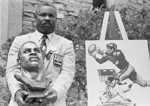 FILE - In this July 30, 1983, file photo, former Cleveland Browns and Washington Redskins halfback and wide receiver Bobby Mitchell poses with his bronze bust after being inducted into the Pro Football Hall of Fame in ceremonies in Canton, Ohio. Mitchell, the speedy late 1950s and 60s NFL offensive star the Browns and the Redskins, has died. He was 84. The Pro Football Hall of Fame said Sunday night, April 5, 2020, that Mitchells family said he died in the afternoon. (AP Photo/Gus Chan, File)