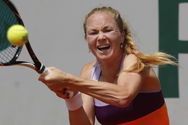 Israel's Julia Glushko returns the ball during the third round match of the French Open tennis tournament against Italy's Sara Errani at the Roland Garros stadium, in Paris, France, Saturday, May 31, 2014. (AP Photo/Michel Euler)