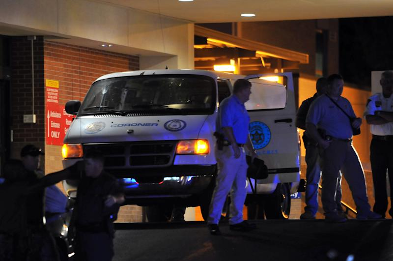 A coroner van holding the body of alleged kidnapper Adam Mayes sits at the emergency entrance of Baptist memorial Hospital-Union County in New Albany Mississippi Thursday May 10, 2012. Mayes who was pronounced dead of a self inflicted gun shot wound is alleged to have kidnapped two sisters Alexandria and Kyliyah Bain. (AP Photo/Alex Gilbert)