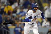 Los Angeles Dodgers' Cody Bellinger drops his bat as he doubles during the seventh inning of a baseball game against the Arizona Diamondbacks Monday, Sept. 13, 2021, in Los Angeles. (AP Photo/Marcio Jose Sanchez)