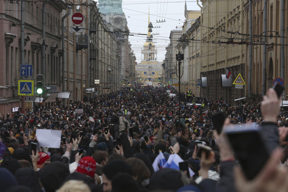 People attend a protest against the jailing of opposition leader Alexei Navalny in in St. Petersburg, Russia, Sunday, Jan. 31, 2021. Thousands of people have taken to the streets across Russia to demand the release of jailed opposition leader Alexei Navalny, keeping up the wave of nationwide protests that have rattled the Kremlin. Hundreds have been detained by police. (AP Photo/Valentin Egorshin)