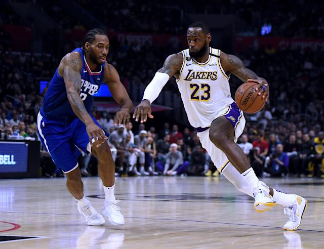 LeBron James drives against Kawhi Leonard during a 112-103 Lakers win at Staples Center on Sunday. (Harry How/Getty Images)
