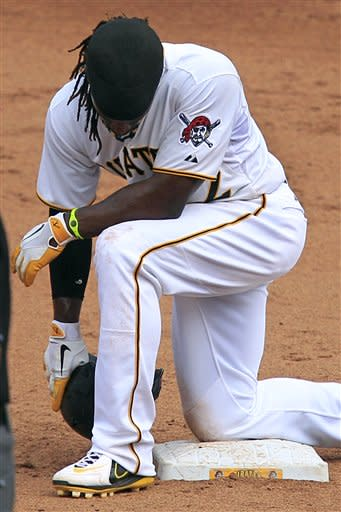 Pittsburgh Pirates' Andrew McCutchen kneels on second base during a pitching change by the Houston Astros during the sixth inning of a baseball game in Pittsburgh, Monday, Sept. 3, 2012. The Astros won 5-1. (AP Photo/Gene J. Puskar)