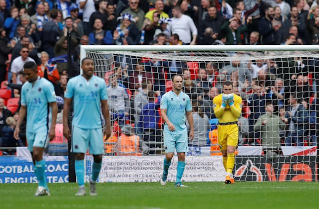 Soccer Football - National League Promotion Final - Tranmere Rovers v Boreham Wood - Wembley Stadium, London, Britain - May 12, 2018 Boreham Woods' Grant Smith looks dejected with team mates after Tranmere's second goal scored by James Norwood Action Images/Andrew Couldridge