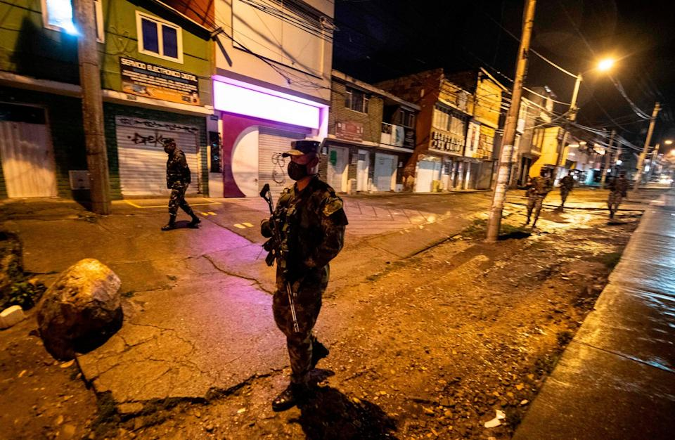 Colombian soldiers patrol the streets in Usme neighborhood, south Bogota, on July 15, 2020: AFP via Getty Images