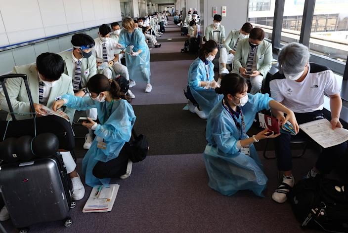 South Korea team members undergo a quarantine process after arriving at Narita International Airport on Monday, ahead of the Tokyo 2020 Olympic Games (Reuters)