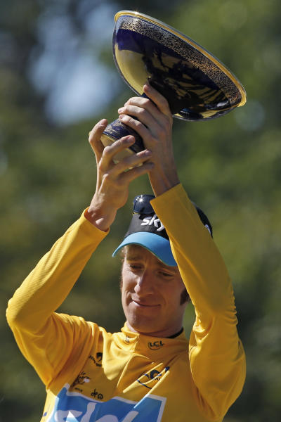 Bradley Wiggins, winner of the 2012 Tour de France cycling race, holds the trophy on the podium of the the Tour de France cycling race in Paris, France, Sunday July 22, 2012. (AP Photo/Laurent Rebours)