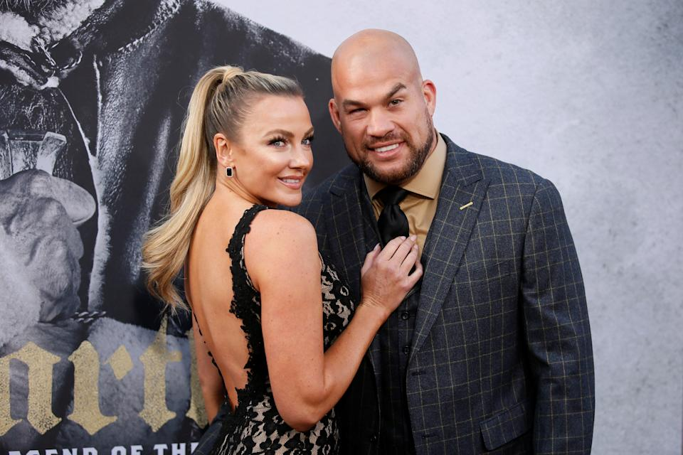 """MMA fighter Tito Ortiz (R) and Amber Nichole Miller (L) pose at the premiere of """"King Arthur: Legend of the Sword"""" at the TCL Chinese Theatre IMAX, in Hollywood, California, U.S., May 8, 2017. REUTERS/Danny Moloshok"""