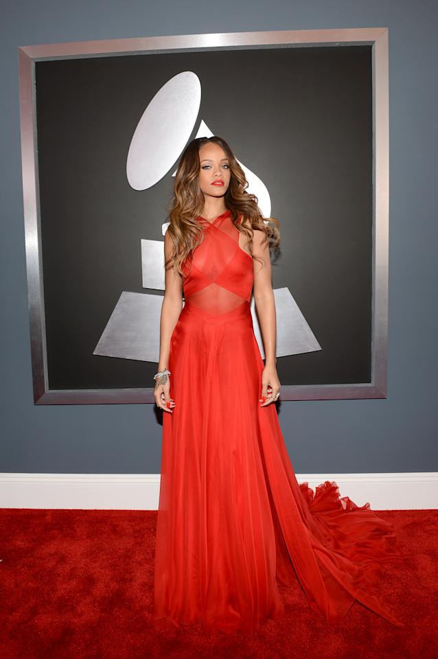 The goddess of edge, Rihanna painted the town red in this custom Azzedine Alaïa dress at the Grammys.