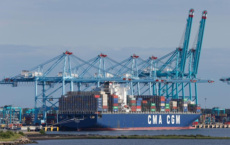 A container ship is unloaded at the Virginia International Gateway terminal in Norfolk, Va., Friday, May 10, 2019. President Donald Trump's latest tariff hike on Chinese goods took effect Friday and Beijing said it would retaliate, escalating a battle over China's technology ambitions and other trade tensions. (AP Photo/Steve Helber)