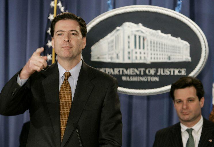 WASHINGTON - DECEMBER 15: Deputy U.S. Attorney General James B. Comey (L) speaks with assistant attorney general Christopher Wray (R) during a news conference at the Justice Department December 15, 2004 in Washington DC. Comey announced that America Online Inc. has entered into an agreement with the government to defer prosecution charges of aiding and abetting securities fraud in connection with transactions between AOL and PurchasePro.com.