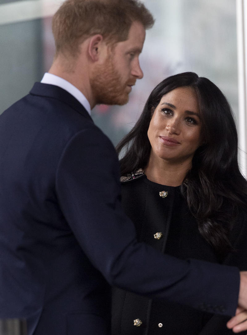 Meghan looks up at Harry during the stop on Tuesday. (Mark Cuthbert via Getty Images)