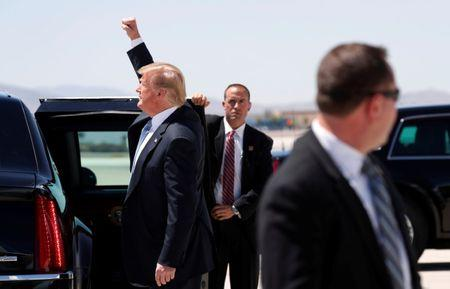 U.S. President Donald Trump waves to supporters upon arrival in Las Vegas, Nevada, U.S., 23, 2018.  REUTERS/Kevin Lamarque