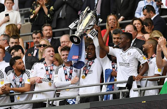 "Soccer Football - Championship Play-Off Final - Fulham vs Aston Villa - Wembley Stadium, London, Britain - May 26, 2018 Fulham's Ryan Sessegnon and team mates celebrate promotion to the Premier League with the trophy Action Images via Reuters/Tony O'Brien EDITORIAL USE ONLY. No use with unauthorized audio, video, data, fixture lists, club/league logos or ""live"" services. Online in-match use limited to 75 images, no video emulation. No use in betting, games or single club/league/player publications. Please contact your account representative for further details."