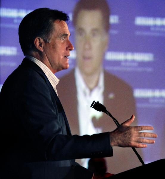 "Republican presidential candidate, former Massachusetts Gov. Mitt Romney speaks at an ""Americans for Prosperity"" campaign event in Troy, Mich., Saturday, Feb. 25, 2012. (AP Photo/Gerald Herbert)"