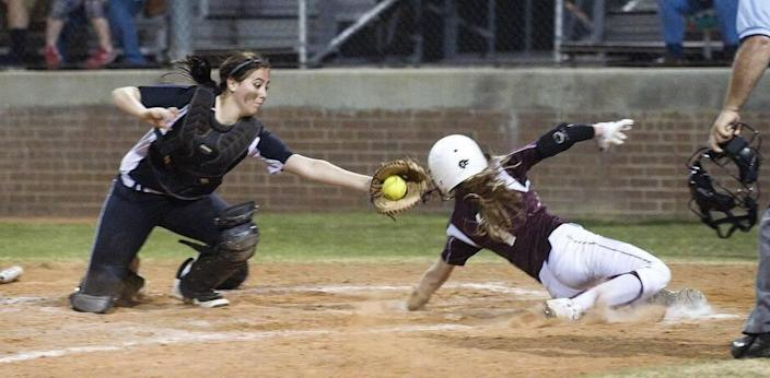 Mansfield's Morgan Rios, left, has caught for varsity all four years of high school.