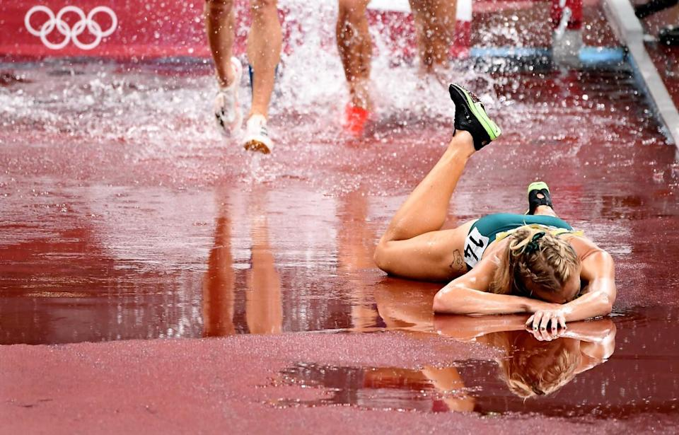 Australia's Genevieve Gregson injures her ankle during the women's 3000m steeplechase