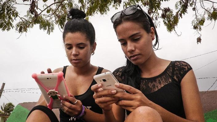 More than two million Cubans live abroad, and with most in the United States, friends and families in Cuba have long been frustrated by the lack of a direct messaging service (AFP Photo/ADALBERTO ROQUE)